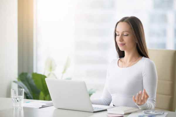 Calm woman in tidy work space