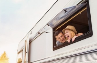 Happy couple in a caravan