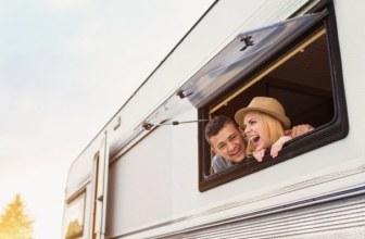 Happy couple in a caravan