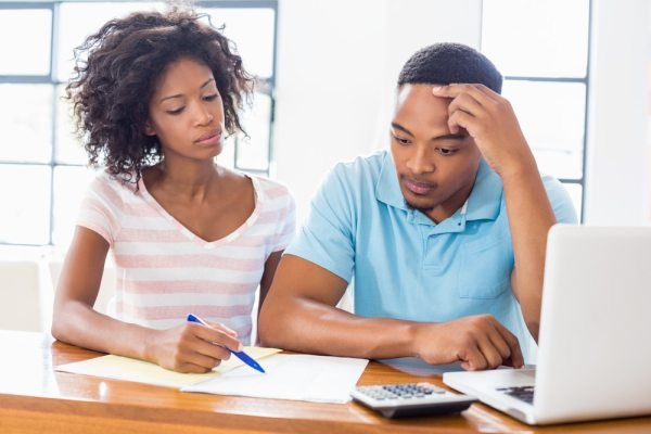 Couple doing financial calculations