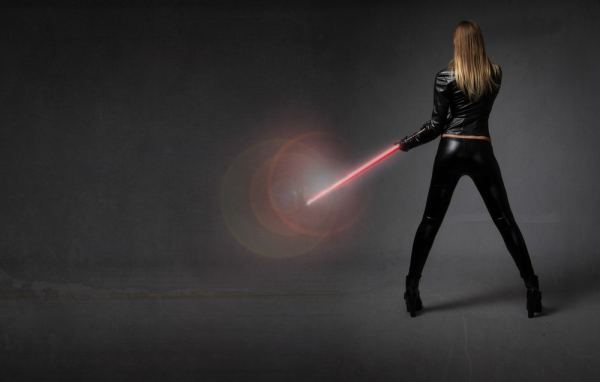 Woman holding lightsaber
