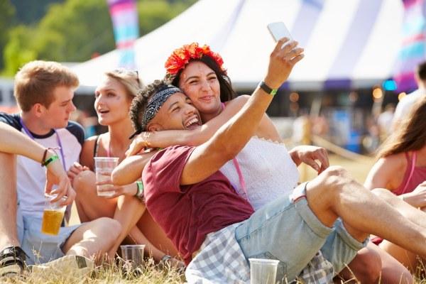 Couple taking selfie at music festival