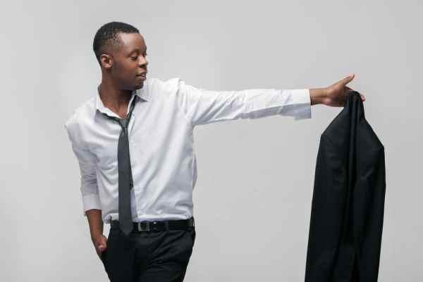 Man taking off suit jacket