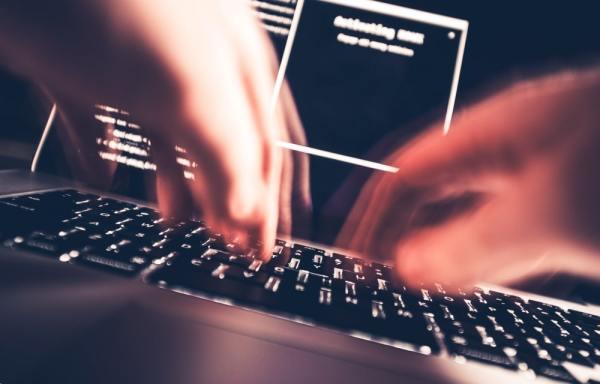 Hacker typing on a keyboard
