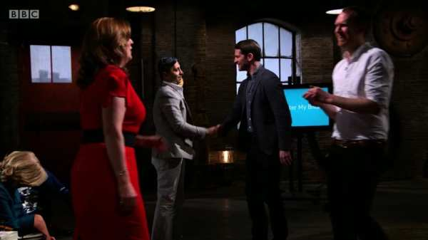 Dragons shaking hands with entrepreneurs