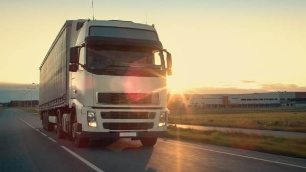 Lorry driving at sunrise
