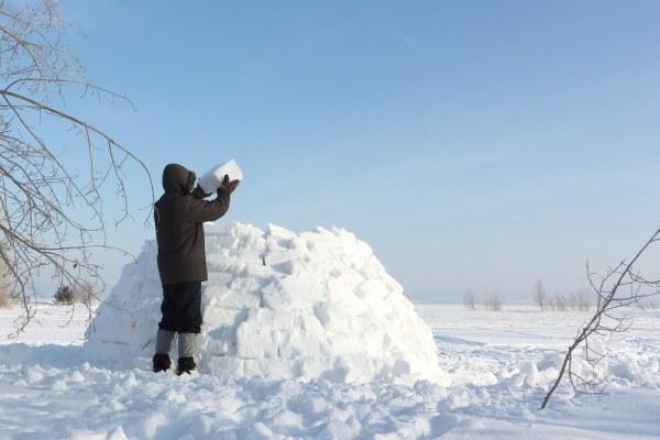 Man building an igloo