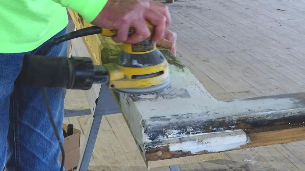 Sanding WoodEpox on a door frame.