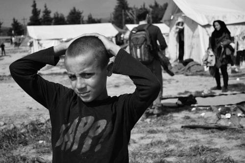 EU-refugees-detention-center-boy-in-Idomeni