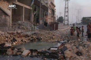 Syrian-children-swim-in-hole-on-street-left-by-airstrikes-2