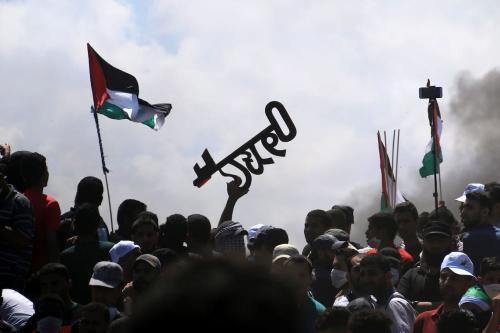 Palestinos em Gaza protestam contra o direito de retornar à sua terra natal em 14 de maio de 2018 [Mahmoud Khattab / Apaimages]