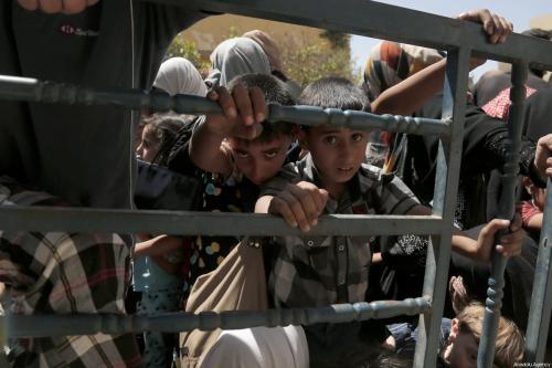 Refugiados iraquianos que fugiram do Estado Islâmico (Daesh), em 16 de maio de 2017 [Yunus Keles/Agência Anadolu]