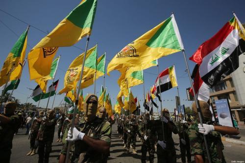 Brigadas do Hezbollah marcham em Bagdá, Iraque, 31 de maio de 2019 [Ahmad al-Rubaye/AFP/Getty Images]