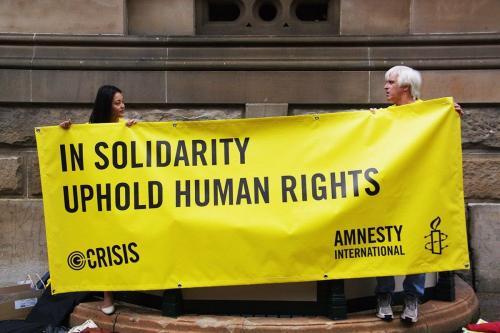 Protesto da Anistia Internacional [Richard Potts/Flickr]