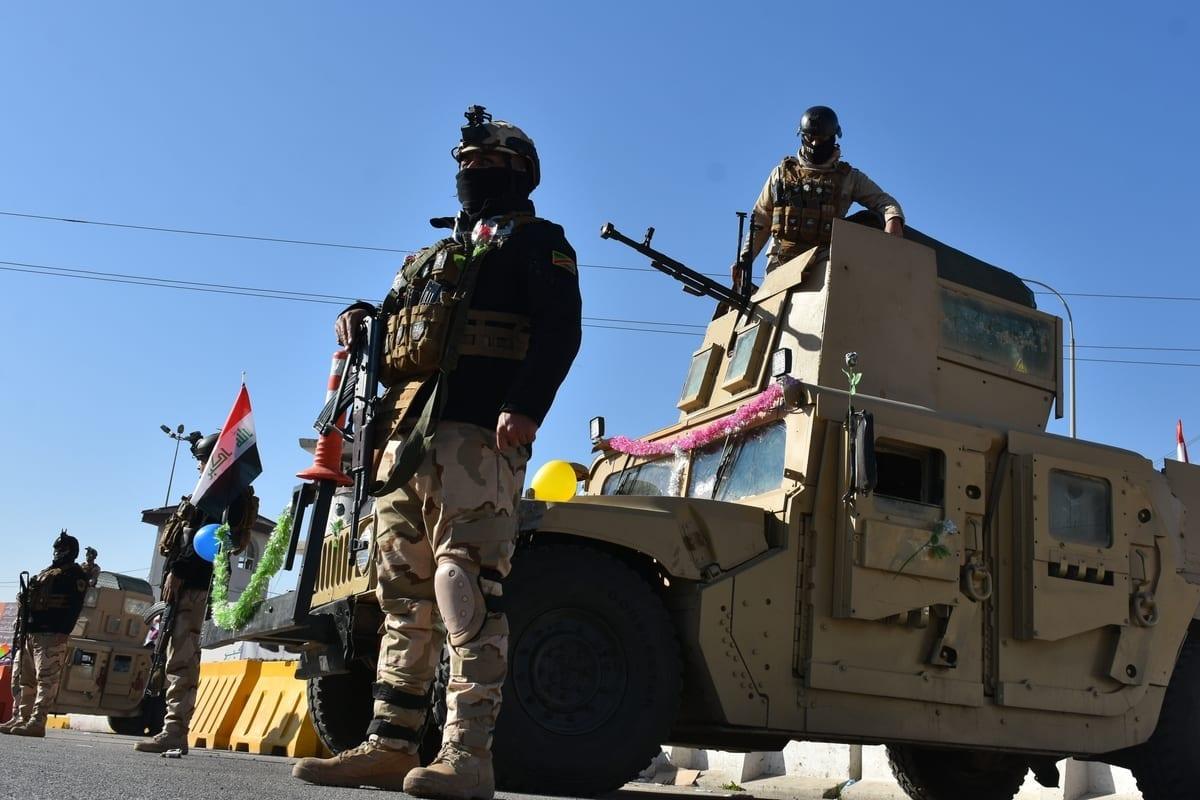 Soldados iraquianos em Kirkuk, Iraque, 3 de janeiro de 2021 [Ali Makram Ghareeb/Agência Anadolu]