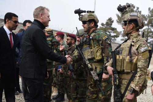 Acting Defense Secretary Patrick M. Shanahan shakes hands with Afghan commandos at Camp Commando, Afghanistan, Feb. 11, 2019.