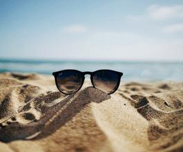 sandy beach with sunglasses