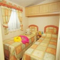 Crantock Holiday Home twin bedroom at Monkey Tree Holiday Park near Newquay