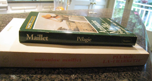 French and English copies of Pélagie-la-Charrette by Antonine Maillet