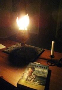 Reading 'Adventures in Solitude' by kerosene lamplight on Savary Island