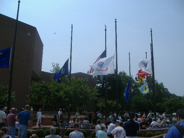 The colors are lowered to half-staff. Custom dictates that on Memorial Day the flag be at half-staff until noon.
