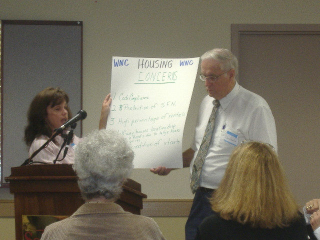 Debbie Campbell and County Councilman David MacLeod go through a list of problems with housing in Wicomico County.