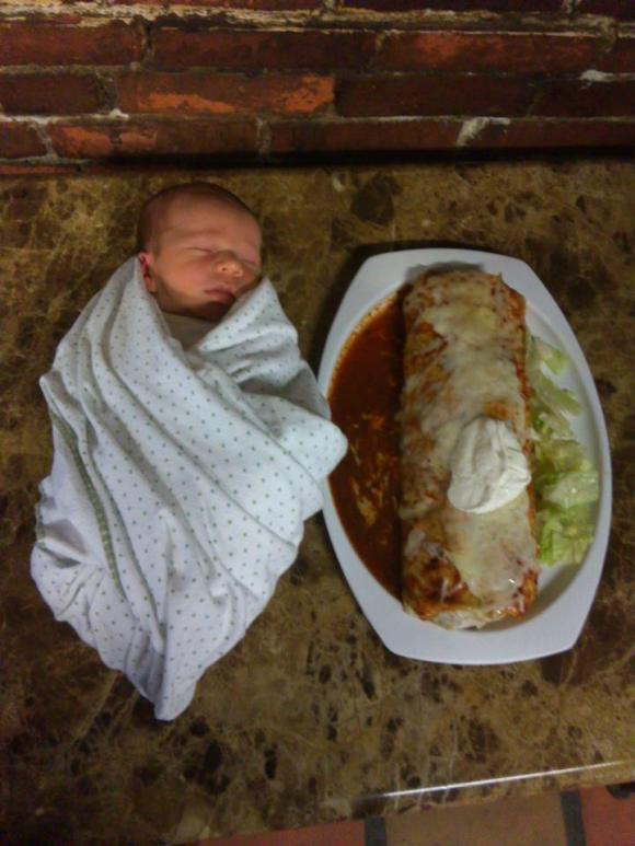 This is an actual photo of my son at a week old next to a giant burrito