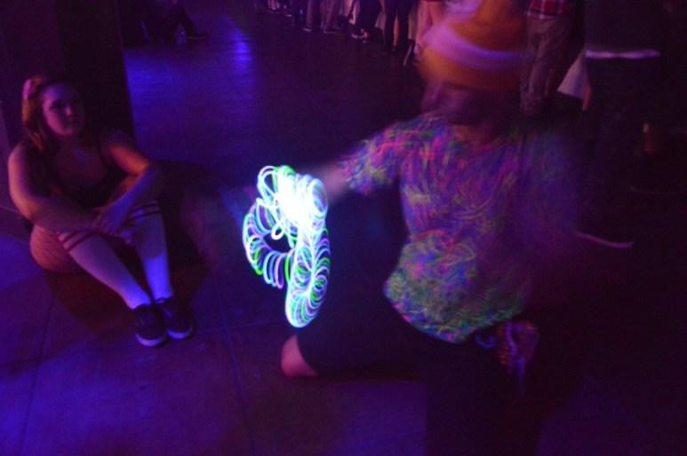 Concert goer giving light show