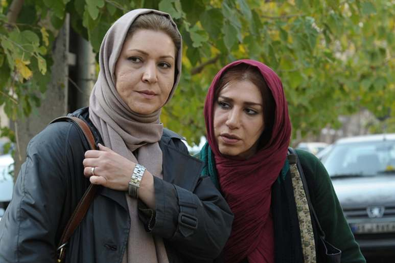 Fariba Khademi and Esmat Rezapour in THE SALE (Iran, 2014) a.k.a. HARAJ, directed by Hossein Shahabi.