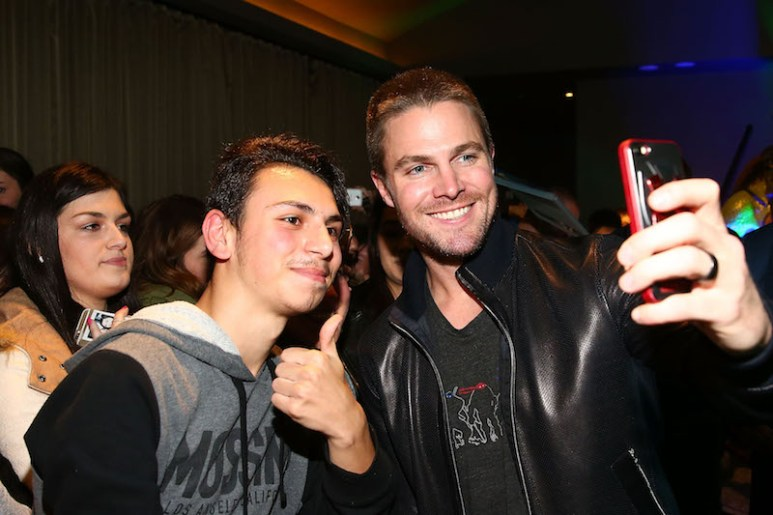 MELBOURNE, AUSTRALIA - MAY 30: Stephen Amell poses for photos with fans as he attends the Teenage Mutant Ninja Turtles: Out of the Shadows fan screening at Village Cinemas Jam Factory on May 30, 2016 in Melbourne, Australia. (Photo by Scott Barbour/Getty Images for Paramount Pictures) *** Local Caption *** Stephen Amell
