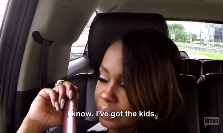 Phaedra talks to her mum on the phone after the bomb threat incident at her office