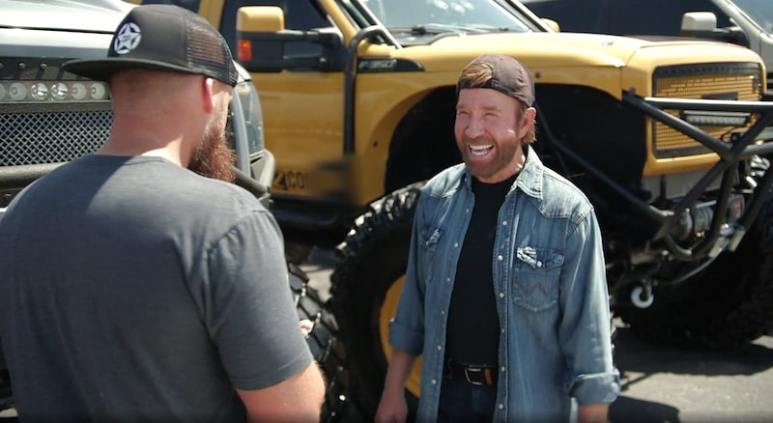 Chuck Norris with the BroDozer behind him during his appearance on Diesel Brothers