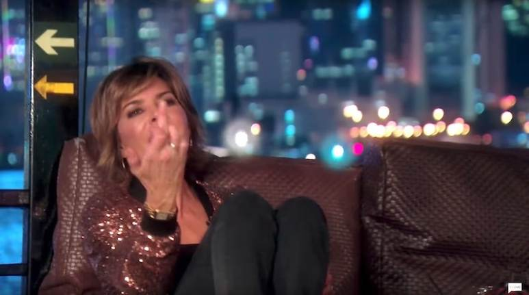 Lisa Rinna sticks her middle finger up at Dorit during the trip to Hong Kong