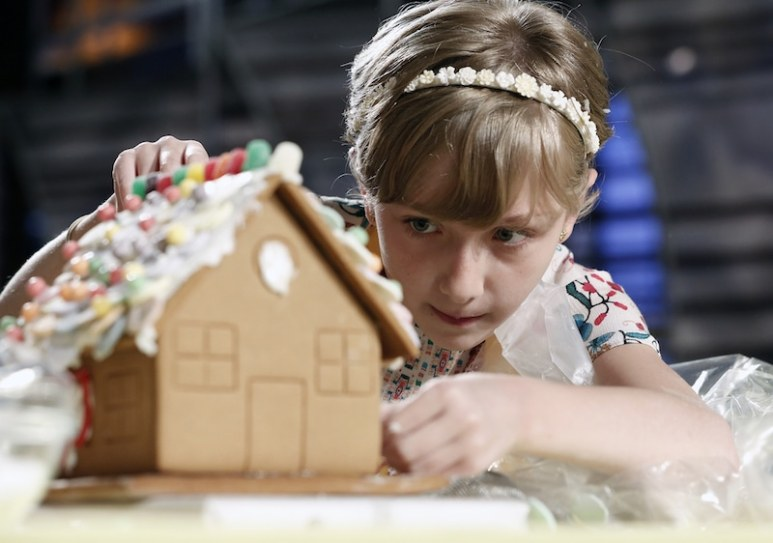 Contestant Cydney recreates the gingerbread house with precision