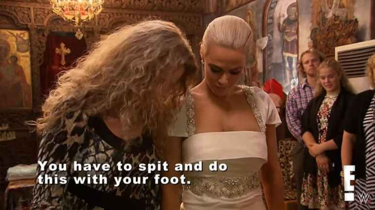 Lana gets talked through the intricacies of a Greek Orthodox christening