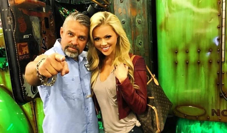 Vegas Rat Rods star Steve Darnell pointing at the camera as he stands next to Angelia Layton
