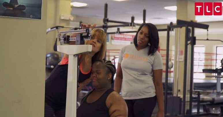Ayanna stands on scales as Allison weighs her