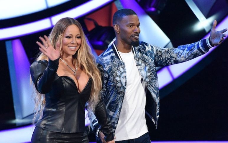 Still of Mariah Carey arriving on stage holding hands with Jamie Foxx on Beat Shazam