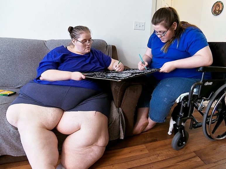 Charity sitting down with her daughter in a still from My 600-lb Life: Where Are They Now?