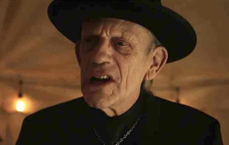 Headshot of Christopher Lloyd as the preacher in 12 Monkeys