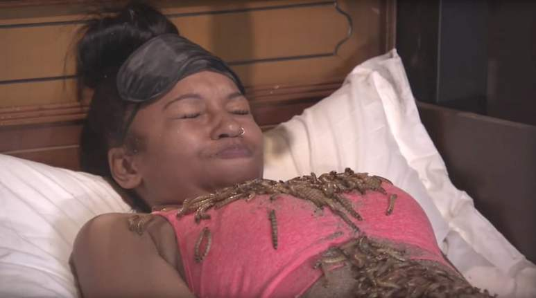 A woman squirms in bed while covered in bugs