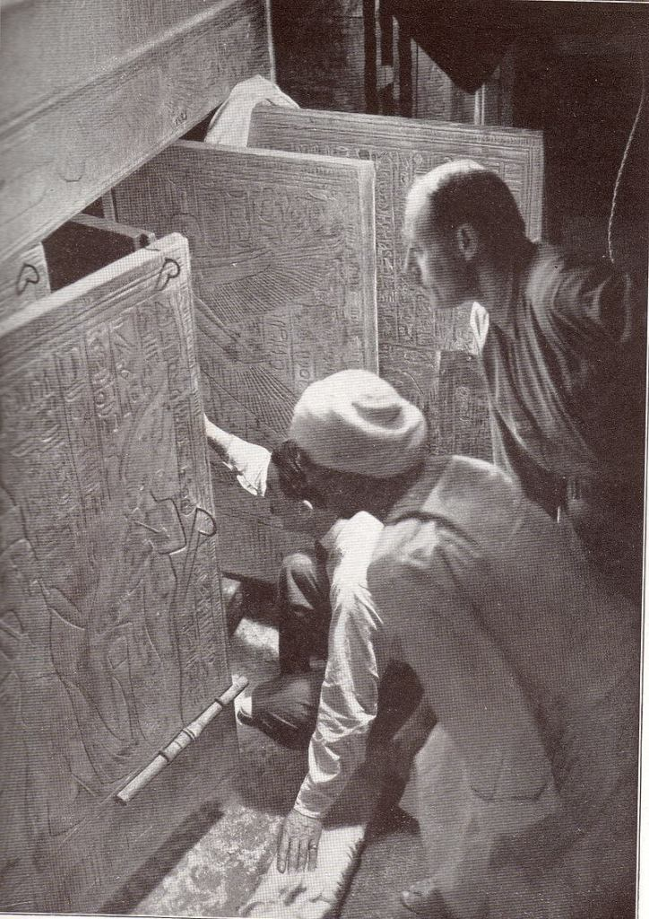 Howard Carter poses in a recreation of the opening of the tomb