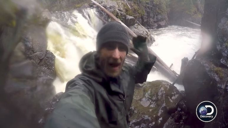 Ben talking to the camera on Devil's Canyon with a waterfall behind him