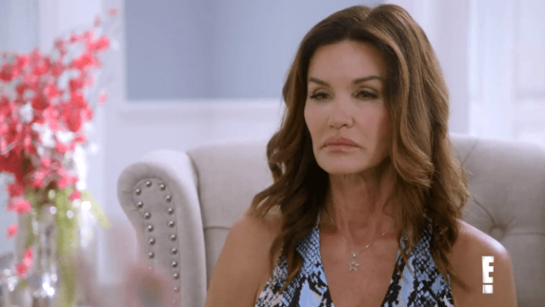 A close-up of Janice Dickinson looking at Tyler Henry, who is off camera, on Hollywood Medium