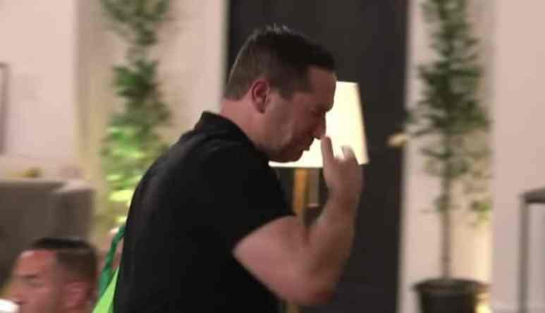 Marc Sorrentino walking out the room with his head in his hand on Marriage Boot Camp: Reality Stars Family Edition