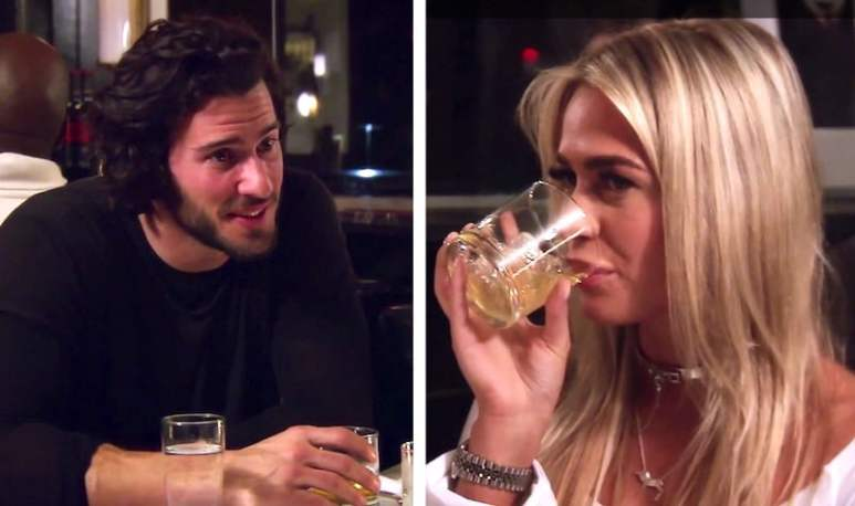 Steve Gold and his date Taylor, who is drinking a whisky, on Million Dollar Listing New York