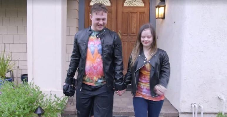 Steven and Megan holding hands as they walk away from a property on Born This Way