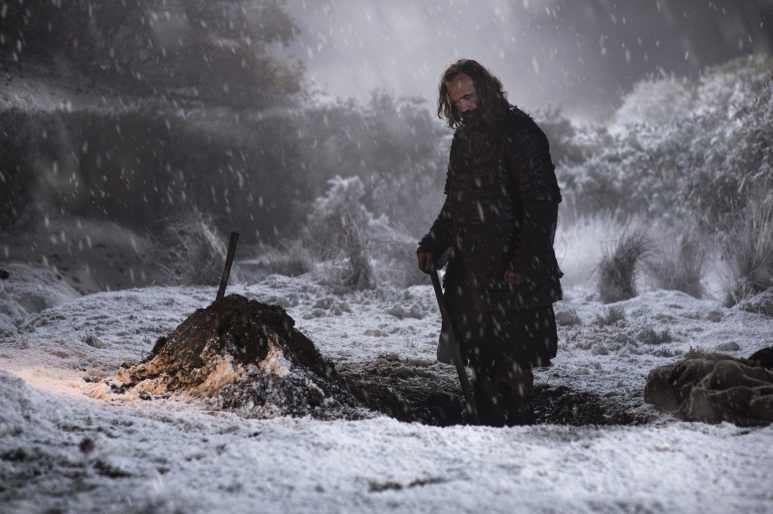Sandor Clegane digging a grave in the snow