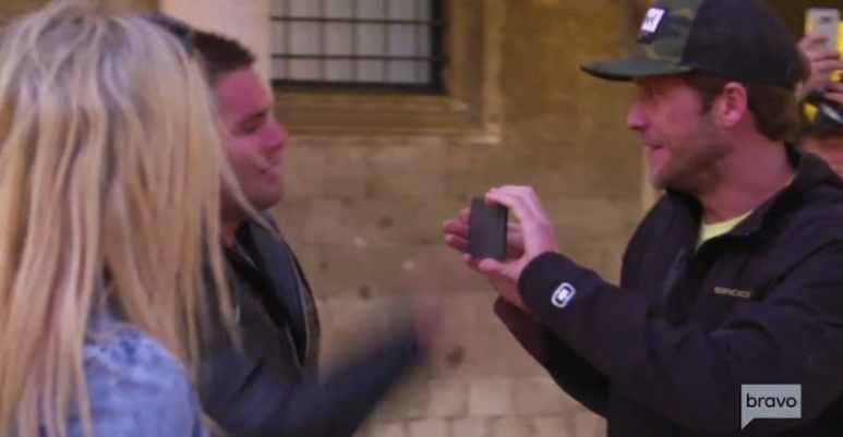 Wes hitting the smartphone out of grinning Adam's hands