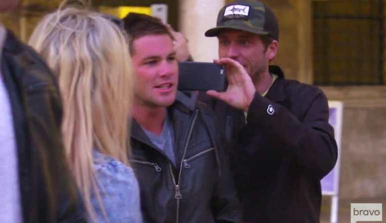 Adam filming a red-faced Wes in a public square in Dubrovnik on Below Deck Mediterranean